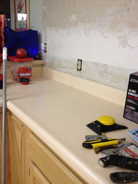 countertops are ugly peach laminate - prefer to find a way to cover ...