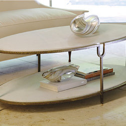Iron And Stone Oval Coffee Table - I love the shape of this coffee table and the natural element that the stone brings. I think the gold finish on the metal will go well with the other gold elements in this space.