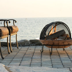 Copper Fire Pit Bowls - Amazing 18 gauge Copper Fire Pit Bowl that is perfect for any style patio or backyard. Pair with Wrought Iron chairs for a great look. Comes in 24, 30 or 36 inch diameters and includes stand, grate and fire bowl. Spark screen available separately.