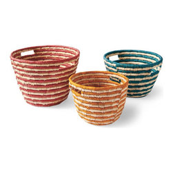 Grandin Road - Set of Three Carmen Sea Grass Baskets - Sturdy enough to organize and carry all sorts of miscellany; attractive enough to add unique visual interest and texture all on their own. Master artisans, with generations of skill, weave each basket individually so your set is one of a kind. Integrated handles offer secure carrying from one location to another. Baskets nest easily for easy storage or display. Set of three offered as shown. Add a colorful touch of exquisite artisan craftsmanship with our hand-woven Carmen Sea Grass Baskets.  .  .  .  .  .
