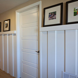 Doors - Call upon a simple—yet elegant—solution for displaying photos with decorative picture rails. Photo courtesy of TRI Pointe Homes.