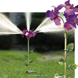"Iris Flower Lawn Sprinkler Yard Stake - Now this is clever. What a great way to keep your sprinkler out full time without junking up the yard. The purple irises are actually quite pretty on their own. I love that they double as a sprinkler and can hook up to your hose with little effort. I always blow off watering because it's ""too hard"" to get the sprinkler out. Anything to make it easier - and more attractive."