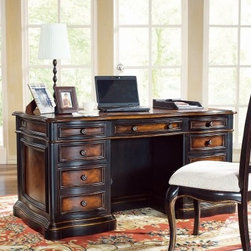 Hooker Preston Ridge Computer Desk - It's true - work isn't always pretty. But your workspace? Well, that can be beautiful, especially if it's the Hooker Preston Ridge Computer Desk. A standout black rub-through finish reveals a warm cherry finish. Subtly molded drawer fronts, antique-style knobs, and a stacked base add dimension. A gorgeous diamond-pattern inlay desktop practically glows. And yes - underneath all that, this desk has a storage system to covet, too.The desk is crafted with durable hardwood solids and select maple veneers over engineered wood, ensuring it resists both moisture and expansion. Seven spacious drawers, including two file drawers that accommodate letter and legal files, four utility drawers, and a center drop-front drawer designed to support a keyboard or laptop. All drawers feature strengthening English or French dovetailing, smooth full-extension steel glides, and sturdy plywood bottoms and sides.The back of the desk isn't plain, either - it's outfitted with a convenient center bookcase with one adjustable shelf, so you can stock books, stationary, and photos with ease. Built-in levelers keep the entire unit firmly in place.Additional Dimensions:Keyboard area: 20.75W x 14.75D x 2.75H inchesKnee space: 19.5W x 18.37D x 23.87H inchesNot available for sale in, or delivery to, the state of California.About Hooker Furniture CorporationFor 83 years, Hooker Furniture Corporation has produced high-quality, innovative home furnishings that seamlessly combine function and elegance. Today, Hooker is one of the nation's premier manufacturers and importers of furniture and seeks to enrich the lives of customers with beautiful, trouble-free home furnishings. The Martinsville, Virginia, based company specializes in lifestyle driven furnishings like entertainment centers, home office furniture, accent tables, and chairs.Construction of Hooker FurnitureHooker Furniture chooses solid woods and select wood veneers over wood frames to construct their high-q