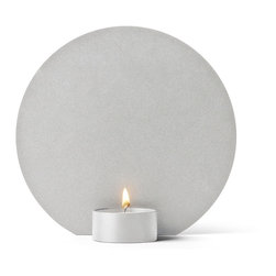 Menu - Shadow Play Tealight, Cool Grey - The Shadow Play Tealight is a charming candle holder for regular tealights. When the candle is lit, the flame will cast its playful, soft shadows on the back piece and the surroundings. Place the holder on a shelf, a table or in the windowsill, and watch as the soft and cosy shadows play.