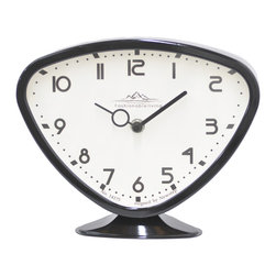 Futuristic Black Table Clock - This table clock is wonderfully mod--a cute and quirky addition to your nightstand or vanity. Battery operated, this clock looks old-school, but not to worry--it's fully up to modern standards!