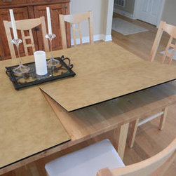 Table Top Pads - Table Pad Factory makes magnetic table pads for your home and office solutions in New York that manufactures also makes custom table pads for dining room, kitchen and conference tables and all other tables. When shopping for table pads contact us.