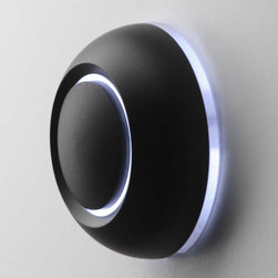 illuminated black True doorbell button by Spore - The black True doorbell comes in three colors of illumination and looks amazing on everything from Spanish Colonials to super modern residences. PC: Spore Inc.