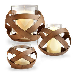 Infinity Candleholder - Loops of brushed copper strapping form the sphere surrounding the Infinity Candleholder, an almost haphazard yet sublimely serene design that lets candlelight shine through the walls for the illusion of movement.  Add a touch of transitional magic to al fresco dining or transitional entryways by pairing this glass and metal hurricane and a pillar candle in a bold color.