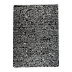 "Berber Dark Grey Rug - 3' x 5'4"" - Deeply shaded in a solid graphite tone, the Berber Dark Grey Rug enhances a space's plush impression while keeping a versatile neutrality that allows it to become a balance point of decor in an urban transitional townhouse or an updated traditional home. Ideal for adding definition to rambling or open floor plans, the rug is made from pure wool for a lush look and feel."