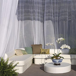 Frontgate - Club Now Zen Collection by La Fete, Patio Furniture - Set includes: (1) Crib (2) Lean (2) Dots. Pre-configured furniture grouping to fit in 8' x 8' floor space with resort bed comfort. Made with all-weather premium yacht vinyl upholstery. Removable covers. Lightweight, strong structural foam. Soak up some rays on our Clue Now Spa Seating Collection by La Fete. This provocative, pre-configured furniture grouping creates the instant cabana; or use the outdoor layout anywhere you want to entertain.. . . . . Super-comfort outdoor cushioning foam. Waterproof encasement. Tested heavy-use with easy clean-ability. 95% recyclable materials. Ships fully assembled. Made in the USA.