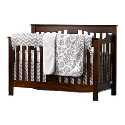"Liz and Roo - Gray Chevron Bumperless Crib Bedding Set - This top seller in gray chevron is gender neutral and opens your nursery to numerous accent colors! The four piece set comes with a rail teething cover, which is a great alternative to a bumper pad, adding beauty to your crib while protecting against teething marks! The crib sheet is soft, egyptian cotton with one inch elastic bands that will hold up wash after wash. The minky (faux fur) receiving blanket has a beautiful gray suzani pattern on one side, reversing to minky. The crib skirt in gray chevron is a 17"" drop. All Liz and Roo Baby Bedding is made in the USA."