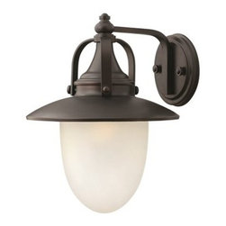 Hinkley Lighting - Hinkley Pembrook Spanish Bronze LED Outdoor Wall Light - Pembrook is a classic all-American style traditional hanging wall lantern. The solid aluminum construction features cast ball knob detailing while the acorn shaped glass make it ideal for Energy Saving and LED conversions.Under four generations of family leadership Hinkley Lighting has transformed from a small outdoor lantern company to a global brand intent on bringing you the best in style quality and value. LIFE AGLOW: That's their mantra and they take it seriously. By welcoming their products into your home they become part of your family's everyday life illuminating small moments and big occasions. They understand your home is so much more than a physical place. It's an emotional space designed by you so they are committed to keeping your 'Life Aglow' with stylish state-of-the-art lighting. Their products are the ultimate combination of style and substance. They are constantly developing new technologies to make their fixtures even more energy efficient. Hinkley recently upgraded their LED to cutting-edge high lumen output integrated solutions and they give you hundreds of energy-efficient styles to choose from. Even their Cleveland-based world headquarters employs high energy saving standards with low VOC materials and a variety of eco-smart applications into the design to make an earth-friendly work environment for their Hinkley family. Hand crafted fixtures luxe finishes artistic details and quality materials go into the design of every product they make. They embrace the philosophy that you can merge together the lighting furniture art and accessories you love into a beautiful environment that defines your own personal style. Specifications Finish: Spanish Bronze Glass Finish: Etched Opal Material: Aluminum Bulb Type: UNI-100 Number Of Bulbs: 1 Wattage Per Bulb: 15W Total Wattage: 15W Bulb Included: Yes Voltage: 120V Safety Rating: C-US Wet Rated Dark Sky Compliant: No Ada Compliant: No Title 24 Compliant: No Install Position: Up Backplate Dimensions: 6W Combo Mount: No Heavy Fixture: No Diffuser: No.