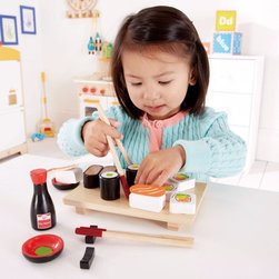 Hape - Hape Sushi Selection - E3130 - Shop for Cooking and Housekeeping from Hayneedle.com! Playing with new foods encourages kids to try different tastes and the Hape Sushi Selection will go a long way in encouraging your little one to try world cuisine. Young sushi chefs will love a sophisticated sushi dinner with all the sushi staples like wasabi soy sauce and chopsticks served beautifully on a realistic serving plate. They might even want to share the spread with a friend or two. Made from fabric bamboo and FSC-certified wood and finished with non-toxic child-safe paint this toy set engages your child in imitative and imaginary play fantasy storytelling role playing and creativity while encouraging social skills through communication cooperation collaboration trust-building and language development. About Hape InternationalDrawing on decades of child development expertise Hape (pronounced hah-pay) International is sensitive to children's needs whenever they develop and design a new toy. Their toys support children throughout every stage of development. This support starts at a very young age to help nurture and develop their natural abilities. Hape International's first priority is to encourage children in their individual development through building their self esteem. With their high-quality toys and games they support children as they play learn interact and grow. Hape understands that children's social emotional intellectual and physical health is a key issue not only for parents but also for a healthy society. That's why they take this responsibility very seriously and conduct a wide range of toy safety tests. The result is safe exciting stimulating toys.