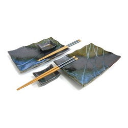 MySushiSet.com - Kasumi Square Sushi Set for Two - Create your own Granite Garden with this lovely sushi set for two. A dramatic steel gray river flows across the rectangular shaped sushi plate that features splashes of sea green and slate blue that is crisscrossed with strips of teal and pale blue. With slightly wavy scalloped edges that add to the drama of this stunning sushi plate set, two small rectangular soy sauce dishes are much more subdued as they angle upward at each end while managing to blend in beautifully. Two pairs of Golden Pagoda Chopsticks that feature a deep blue mosaic design on a golden wood finish add a nice finishing touch to this sushi gift set.
