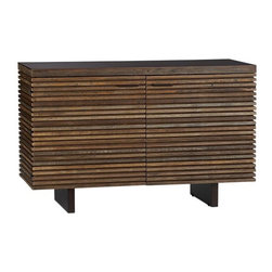 Paloma Small Sideboard | Crate&Barrel - The wood slats on this groovy sideboard are reclaimed from old buildings, giving it the look of the coolest vintage find one could ever hope for. Designed for dining room storage, it also has cut outs for cords so that you can opt to use it as a television stand.