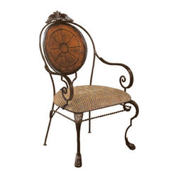 Ambella Home - Mushroom Arm Chair - This lush chair is both fanciful and simple.  The seamless flow of its rustic wrought iron curves give way to a sundial-patterned leather backrest and buttery soft seating. Dimensions: 24 in. x 19 in. x 41 in.