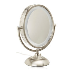 Jerdon HL955N 8-Inch Tabletop Two-Sided Swivel Oval Halo Lighted Vanity Mirror - The Jerdon HL955N 8-Inch Tabletop Two-Sided Swivel Oval Halo Lighted Vanity Mirror is an ideal bathroom and makeup accessory that provides lighting and magnification options to display a clean, bright reflection whenever you need it. The fog free, two-sided oval mirror is 8-inches by 10-inches in size and features a smooth 360-degree swivel design that provides 1x and 5x magnification to make sure every detail of your hair and makeup are in place. The oval light design and smooth rotation adjusts to all angles for a dynamic point of view. This item can use the JPT25W replacement bulb (sold separately). An on/off rotary knob on the back base will activate the oval lighting around the perimeter of the mirror when you need it. The HL955N stands 13.75-inches high, stands upright on countertops, vanities and tables and has an attractive nickel finish that protects against moisture and condensation. The Jerdon HL955N 8-Inch Tabletop Two-Sided Swivel Oval Halo Lighted Vanity Mirror comes with a 1-year limited warranty that protects against any defects due to faulty material or workmanship. The Jerdon Style company has earned a reputation for excellence in the beauty industry with its broad range of quality cosmetic mirrors (including vanity, lighted and wall mount mirrors), hair dryers and other styling appliances. Since 1977, the Jerdon brand has been a leading provider to the finest homes, hotels, resorts, cruise ships and spas worldwide. The company continues to build its position in the market by both improving its existing line with the latest technology, developing new products and expanding its offerings to meet the growing needs of its customers.