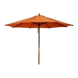 Round Pulley Patio Umbrella, Orange, 9' - Outdoor umbrellas are both beautiful and functional, and they will keep the sun off your face when dining outdoors. I love the tangerine hue here.