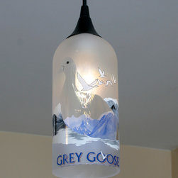WickedBuy - Upcycled Grey Goose Hanging Pendant Lamp made from a vodka bottle - This is one of my favorite lighting fixtures I have created so far. Made with a Grey Goose vodka bottle, this pendant lamp is a perfect fit in the home of the Goose lover! The globe is hand crafted from a 1.5 liter Grey Goose Vodka bottle creating a unique look and is environmentally friendly! This beautiful Grey Goose light fits in well with any decor and would look awesome above a pool table, bar, kitchen island, in a restaurant, or anywhere you need a high class, hand crafted light. The globe measures 4 inches in diameter and 9 inches tall.