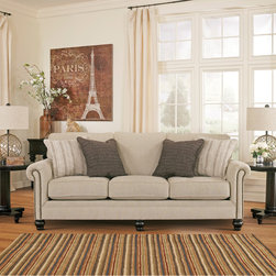 Signature Design by Ashley - Signature Design by Ashley Milari Linen Sofa - Upholstered in neutral linen-tones, this elegant Milari sofa features classic rolled arms studded with nailhead trim, plush cushions and sturdy bun feet. Blending comfort and elegant, enjoy the luxurious feel of this Milari sofa with a sleeper option.