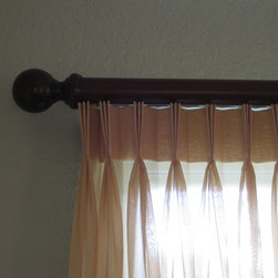 Master Bedroom - pleated sheers on estate rods - This close up shows the beautiful estate rod in mahogany with ball finials.