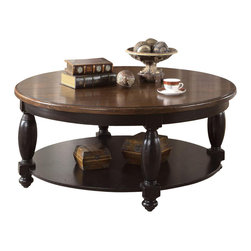 Riverside Furniture - Riverside Delcastle Round Cocktail Table in Aged Black - Riverside Furniture - Coffee Tables - 41204 - The Arkansas River Valley is home of majestic forests ruggedly beautiful mountains gurgling brooks and swiftly flowing rivers. It is also the home of Riverside Furniture Corporation. But like they would with any old friend most folks refer to us just by our first name. Riverside has been growing with America for more than half a century now and since then Riverside has been a name three generations of Americans who have furnished their homes and offices with our wide range of furniture products. We want the Riverside name to be trusted for quality products that are an affordable value. It's just that simple.