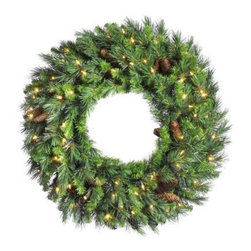 30 in. Cheyenne Pine Pre-lit Christmas Wreath with Cones - Thick and natural-looking the 30-Inch Cheyenne Pine Pre-Lit Christmas Wreath with Cones comes pre-lit with 70 clear mini lights that sparkle and twinkle merrily. The pinecones throughout the wreath add a warm touch that is perfect for the holidays.About VickermanThis product is proudly made by Vickerman a leader in high quality holiday decor. Founded in 1940 the Vickerman Company has established itself as an innovative company dedicated to exceeding the expectations of their customers. With a wide variety of remarkably realistic looking foliage greenery and beautiful trees Vickerman is a name you can trust for helping you create beloved holiday memories year after year.