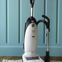 "Miele Cat & Dog Upright Vacuum - I know that all Houzz users love their furry friends, but that doesn't mean you always love the furry mess they leave on your furniture and floors. This vacuum is all about clearing the air...literally. While it powerfully sucks up all the pet hair that Fido leaves behind, it also prevents the fur from recycling back into the air.dimensions: 13.5"" x 13"" x 46"". 39' cord. 6-qt. cap. dust bag. 21 lb. 12000W. made in Germany."