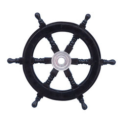 "Handcrafted Model Ships - Deluxe Class Black and Chrome Ship Steering Wheel 12"" - Wooden Ship Wheel - The Hampton Nautical Wooden Black Pirate Ship's Wheel 12"" meshes a chrome and black wood together in one amazing ship wheel. Made from rare, high quality Shisham wood imported from India, a hardwood similar to teak that is highly regarded for its ability to resist foul weather and the elements. The ship wheel has six spokes, each skillfully turned and assembled with plugged screw heads. The solid chrome center hubs have a standard one-inch diameter hole and machined keyways."