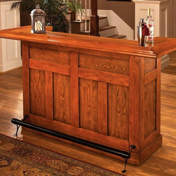 Hillsdale - Classic Home Bar w Black Footrest - This stylish solid oak bar will make a great focal point in any setting. This bar comes with a foot rail, wine storage for up to 12 bottles and cabinets and drawers in the back for storage. There is also a dry sink and four garnish trays making this the perfect bar for any home. Save $400 on the Classic Oak Large Bar and set yourself up with a versatile serving center that�۪s both handsome and durable. Lustrous footrest on the front panel adds to the stylish good looks. * Wine rack accommodates 12 bottles. Cabinets & drawers for additional storage space. Constructed of durable Oak and Oak veneers. Black footrest. Pictured in Medium Oak finish. Some assembly required. 78 in. L x 26.5 in. W x 42.75 in. H (294 lbs.)The Classic Medium Oak Large Bar dresses up any decor. Constructed with solid hardwood and Medium Oak veneers. This bar is charming enough for home use and durable enough for commercial use. Offers plenty of space for all your glassware, supplies, and consumables