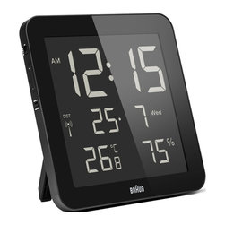 Braun - Braun BNC014 Global Radio Controlled Digital Wall Clock - The Braun Global Radio Controlled Wall Clock has a superior reverse LCD display which shows the time, alarm time, date, day of the week, indoor temperature and indoor humidity. The clock has a quick set function for easy use and can be set to 12 or 24 hour mode. The radio controlled function can be switched off and the clock can be manually set for use in those countries where the radio controlled signal is not picked up. The clock also has a folding table stand. Available in 2 colours.