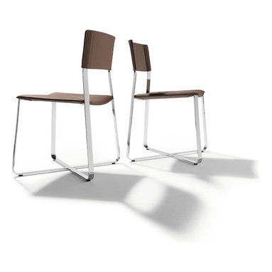 Lux designer dining chair - The Red Dot 'best of year' design award winning Lux dining chair is a true market innovation. The frame has been luxuriously engineered to offer flexibility in all directions - created by the flat steel frame. The seat and backrest are leather covered.