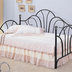 Coaster - Traditional Twin Size Daybed in Black - The high fan shaped back creates an elegant look, with filigree knobs accenting each post. This bed offers a great place to relax during the day, and an ideal spot to sleep at bedtime.