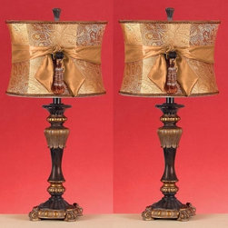 Aspire - Michelle Table Lamp - Set of 2 - Set of 2. These lovely table lamps boast a very unique design with gold and deep purple-brown on the base and a lovely bow and tassel tied around the elegant paisley shade. Polystone. Color/Finish: Dark purple/brown, Gold. UL listed. Uses 60 watt max bulb. 26 in. H x 12 in. W x 12 in. D. Shade: 9 in. H x 12 in. W x 12 in. D. Weight: 11 lbs.