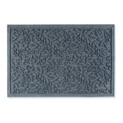 """Frontgate - WATER & DIRT SHIELD ™ Fall Day Door Mat - 100% polypropylene construction. Special deep channels trap damaging dirt and direct moisture away from shoes. Even small sizes can hold up to 1 gallon of water. Fade-resistant. Will not deteriorate. Our sturdy WATER & DIRT SHIELD ™ Fall Day Door Mat takes on even the muddiest tracks. This super strong mat protects floors with thick fibers that absorb moisture and whisk mud from your pet's feet or your shoes.. . . . . Suitable for all floor types. Slip-resistant backing keeps mat in place. Surface wash with mild detergent or simply rinse with hose. Mats are 1/4"""" thick. Note: Do not place on wet floors. Made in USA. A Frontgate exclusive."""