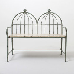 Birdcage Iron Bench - This birdcage-motif bench is made with wrought iron. I see it on a covered veranda.