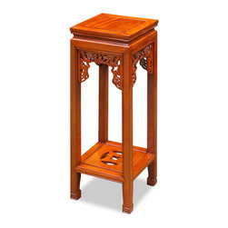 China Furniture and Arts - 30in Rosewood Dragon Motif Pedestal - A quintessential item of Chinese furniture, our pedestal with hand-carved dragon design brings your back to the splendor of imperial court, where such a pedestal was often used to display the emperor's valued blue-and-white ceramic vases. The shape of an ancient coin is hand-carved on the lower shelf. Made of solid rosewood with joinery technique for long lasting durability. Hand applied beautiful natural finish enhances the beauty of the wood grain. (Assembled.)
