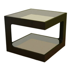 Baxton Studio - Baxton Studio Clara Glass Square Side Table - A unique side table option, this professional-looking contemporary Table's dual tempered glass surfaces for storage and display. The black oak frame descends from the top surface to the bottom in two opposite corners, leaving the bottom space more open with a wider gap for easy access. Consider purchasing either two or four of this design and arranging them together as a coffee table. Glass of the table is colorless.