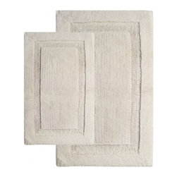 """Chesapeake Merchandising - 2 Piece Olympia Bath Rug Set in Ivory - Luxurious and Comforting bath rug.  The Olympia Collection adds luxury to any bathroom.  Spun from 100% Cotton.  This bath rug is plush under foot and comes in 4 colors to coordinate with your bathroom decor. Machine Tufted with anti skid spray latex back.  This bath rug set includes a 21""""x34"""" and 24""""x40"""" Bath Rug. Dimensions: 21""""W X 34""""L and 24""""W X 40""""L; Color: Ivory; Material:  Cotton; Shape: Rectangular; Construction: Machine Tufted and Powerloom"""