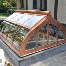 Repurposed greenhouse to skylight.  Steel skeleton, wood exoskeleton and wrapped