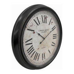 24 In. Diameter Round Metal Wall Clock `London Bridge Station` - This large wall clock adds an antique accent to your home or office, and it is sure to be admired. It has a metal frame, glass clock face, and measures 24 inches in diameter, 3 inches deep. The clock face reads, `London Bridge Station, Platform 2,` and has a wonderful distressed finish. Large, bold Roman numerals and black hands make the clock easy to read, even if it is displayed high up on the wall. The clock features quartz movement, and runs on 1 AA battery (not included). This piece also makes a great housewarming gift.