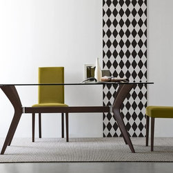 "Tokyo Table by Calligaris - The Tokyo Dining Table by Calligaris deatures a rectangular tempered glass top that stretches 71"" wide. Multiple sizes are available for consumers who love this contemporary style and leg finish. Size options are 71"" by 36"", next is 63"" by 36"", or lastly a circular option of 44"" diameter. Wood colors can be chosen between Walnut and Wenge, and glass colors could be Frosted Black or Transparent. The Chairs pictured are Latina Chairs that are also available in a variety of finishes by Calligaris."