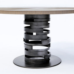 "Cyclo Table - Dynamically composed of finely crafted materials, the Cyclo Table exudes an elegant sculptural presence.  Inspired by the cyclical and random patterns in nature, its textural quality and layered transparency form an heirloom piece that is assured to be the focal point of any room.  Custom sizes and finishes (polished stainless steel, molten nickel, walnut, etc.)  are available.  Standard in 48"", 54"", 60"", 66"", etc. diameters."