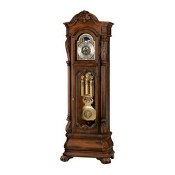 Howard Miller - Howard Miller Hamlin Grandfather Clock Multicolor - 611025 - Shop for Clocks from Hayneedle.com! The Howard Miller Hamlin Grandfather Clock is a truly exquisite heirloom piece that will mark the most memorable moments in your life. This magnificent floor clock features a distressed Rustic Cherry finish on select hardwoods and veneers. A carved shell and leaf design draws the eye up to the arched pediment which is embellished with decorative overlays on the canted corners.Cast corners and center ornaments accent the brushed antique brass dial which includes a silver chapter ring with applied brass Arabic numerals and an astrological blue moon phase dial. Mirroring the dial the lyre pendulum is brushed antique brass with a decorative antique gold-finished center disk.The lower front door features beveled glass and decorative overlays with matching shell and leaf designs allowing you to see the inner functions of the clock. Canted reeded columns frame the case offering intricately carved column caps with a unique scroll design and Acanthus leaf details. The multi-tiered Bombay base has canted corners and carved scroll feet with Acanthus leaf details. If you need access to the movement you will appreciate the removable beveled glass panels on the upper side. The cable-driven triple-chime Kieninger movement features an automatic nighttime chime shut-off option. This clock also features a locking door for added security. Adjustable levelers under all corners level the clock on uneven or carpeted floors.About Howard MillerBeginning in the 1920's Howard Miller clocks have impressed all who see them with superior quality and design. Howard Miller wall floor and mantel clocks are crafted to last for generations and to perfectly accent your home.The company's founder Howard C. Miller began manufacturing wall and mantel clocks in Michigan. Evolving to encompass cabinet making and other furniture design - all renowned for quality and style - the Howard Miller com