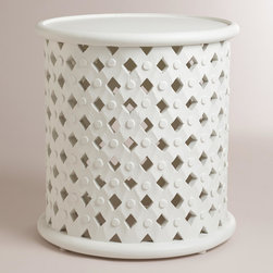 World Market - White Tribal Carved Accent Table - Hand carved of mango wood by artisans in India, our White Tribal Carved Accent Table lends an eclectic look to any space. In a trending color, its surface is perfect for a lamp, vase of flowers, plant or picture display.