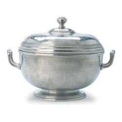 "Match Pewter - Round Soup Tureen by Match Pewter - The round soup tureen is hand forged in Italy and bears a symbol from the region in which it was made. Match pewter is a testament to the values of craft and authorship often overlooked in this age of speed and convenience. Hand-wash this piece in warm water using liquid dish soap. Dry the pewter completely.  9.8"" diameter x 9.3"" high"