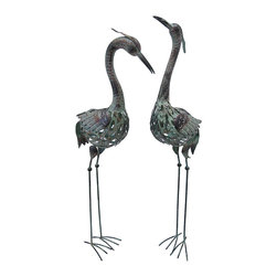 Zeckos - Pair of Metal Crane Statues Lawn and Garden Decor - This pair of metal cranes adds a wonderful decorative accent to your home or garden. The tallest one measures 41 inches tall, 11 inches long, 4 1/2 inches wide, the shorter one is 39 inches tall, 11 inches long, 4 1/2 inches wide. They are a lovely addition to flower beds, porches, or patios, and make a great gift.