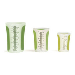 Nesting Measuring Cups with Lids - Set of 3 - Get a grip . . . on this set of nesting measuring cups with lids. Pinch the silicone sides to engage the spout for easy pouring. Microwave and dishwasher safe, these cups make the best little helpers to have in your kitchen.