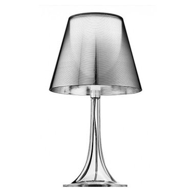 """Flos - Flos Miss K table lamp - The external diffuser is completelty finished with a high-vacuum aluminization process. The Miss K table lamp has a conventional dimmer for 0 to 100% luminosity adjustment with transparent cover fitted on the transparent polarized.  Product description:  The Flos Miss K table lamp is designed by Phillipe Starck for Flos.This table lamp is providing diffused light. The diffuser of this pretty table lamp is made from a fully transparent, injection-molded PMMA polymethylmethacrylate. The external diffuser is completelty finished with a high-vacuum aluminization process. The Miss K table lamp has a conventional dimmer for 0 to 100% luminosity adjustment with translucent cover fitted on the translucent polarized cord. In stock and ready to ship! UL listed!   Details:     Manufacturer: Flos   Designer: Phillipe Starck   Made in: Italy   Dimensions: Height H:17,01"""" diameter:9,29""""    Light bulb: max. 100W incand.   Material polymethylmethacrylate     Flos is the Italian creator of contemporary light fixtures that was founded in 1962. THe light structures of the company can be found in many countries across the globe-in hotels, homes, restaurants, and more. They are also regularly featured at events and exhibits.  Miss K Table Lamp"""