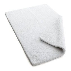 Traverse Reversible White Bath Rug - Soft, absorbent pile lays out a plush welcome mat to excess water. Cotton rug reverses to same.